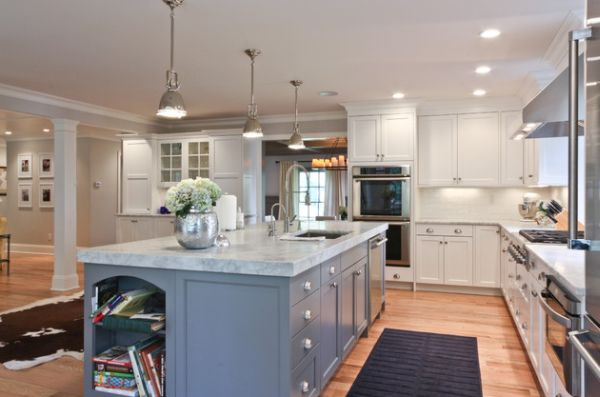 View in gallery Long kitchen island with marble countertop lit up using  Benson pendant lights