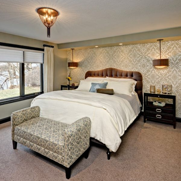 Master bedroom with a king-sized bed and a bench with fun pattern