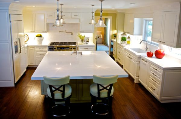Mercury glass pendants make a fine addition to this elegant white kitchen with a touch of green