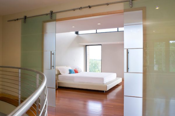 Minimalist bedroom with translucent sliding glass walls