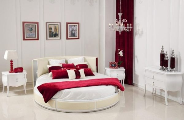 Modern bedroom in a white and red theme with a stylish circle bed