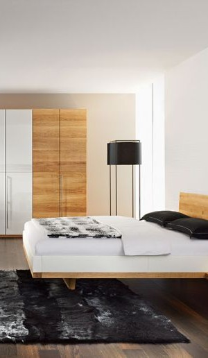 Modern bedroom sporting a chic floating bed design