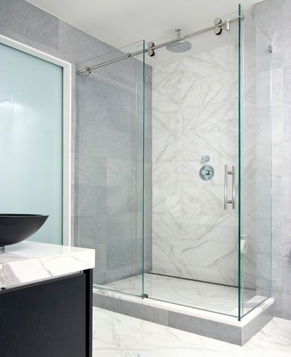 Modern minimalist shower enclosure encased in glass