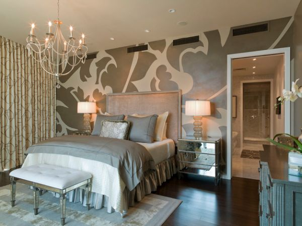 Mural wall, cool chandelier and a tufted bench with acrylic legs make this bedroom unique