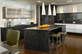 Pavia pendant lights illuminate this kitchen counter in black marble