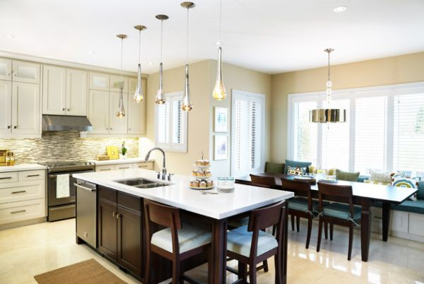 pendant lights above kitchen island hung at different heights to. Black Bedroom Furniture Sets. Home Design Ideas