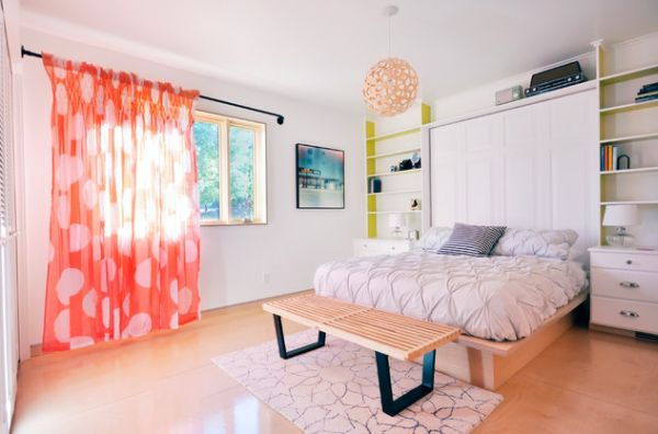 Playful bedroom with Nelson Platform bench and bright orange drapes!