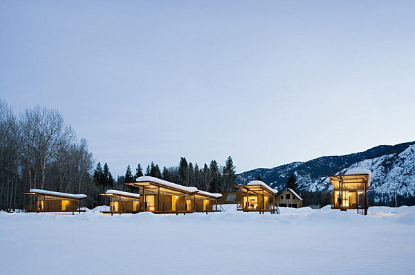 Rolling huts in the snowy landscape