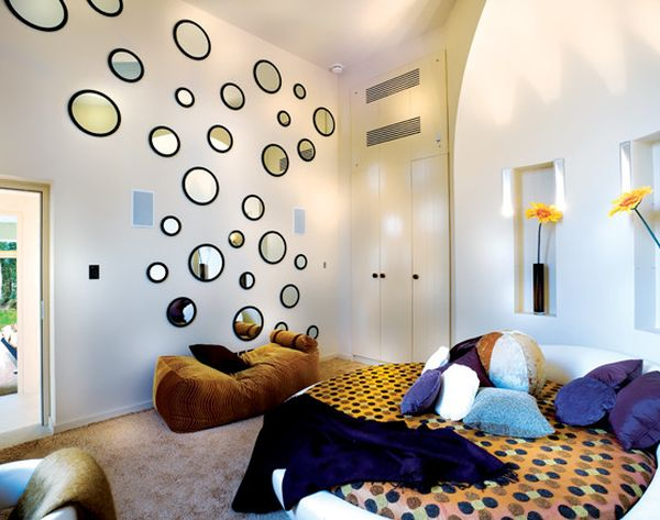 Round bed and circular mirrors on the walls help bring back the 70s in style!
