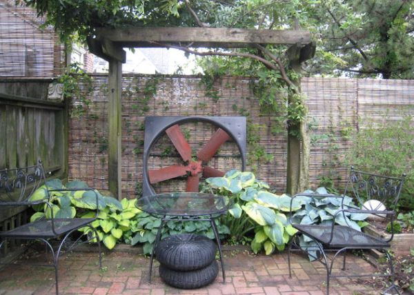 Salvaged industrial fan gives this garden a rustic and unique look
