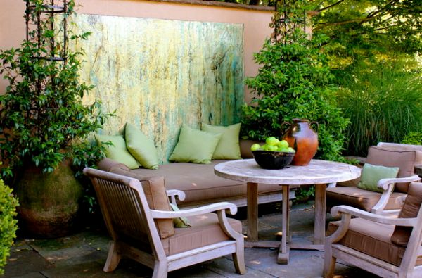 Seating area in colors that blend well with green makes for a useful art installation