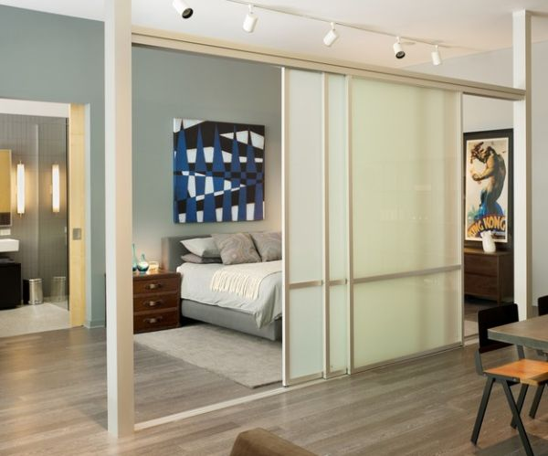 Separation with sliding glass doors and rail lighting for the bedroom