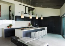 Sleek kitchen in black and white with lovely pendant lighting