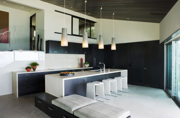 Sleek kitchen in black and white with lovely pendant for Sleek modern kitchen ideas