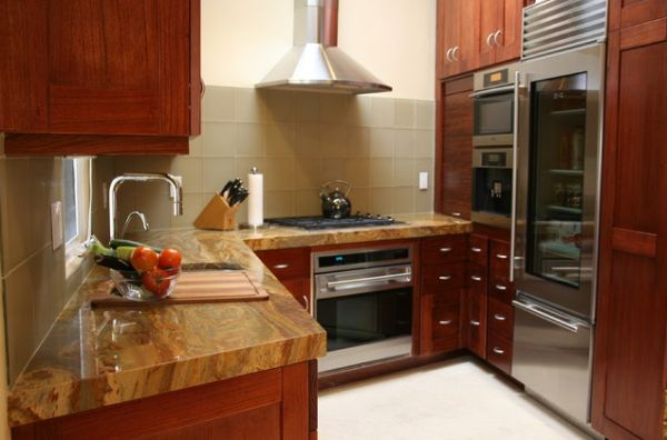 Sleek refrigerator with metal doors nicely used in a kitchen with largely wooden surfaces
