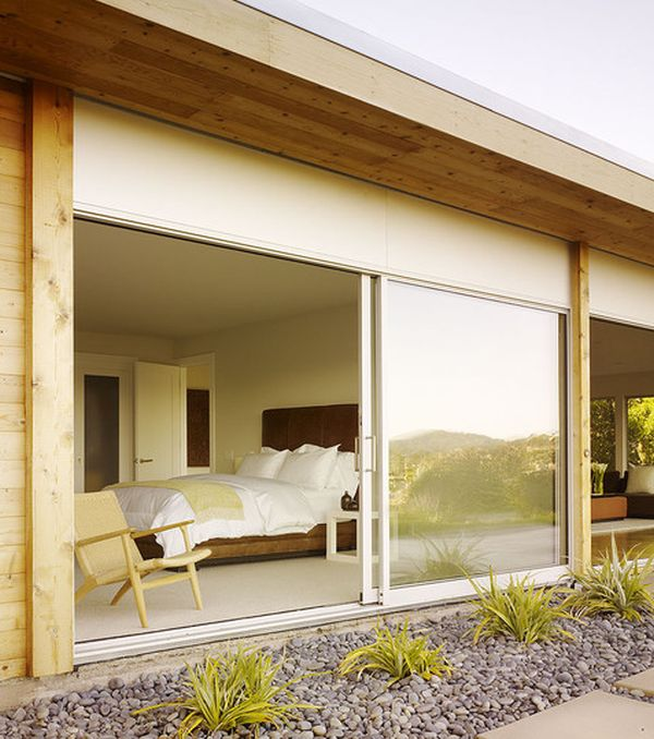 Sliding glass doors bring in freshness into this modern bedroom