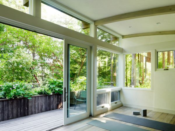 Sliding glass doors providing views of sunrise and the trees