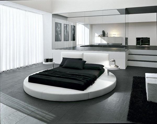 Sophisticated contemporary bedroom with ergonomic round bed at its heart