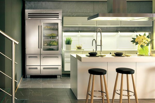 Stunning and sleek kitchen with glass front refrigerator