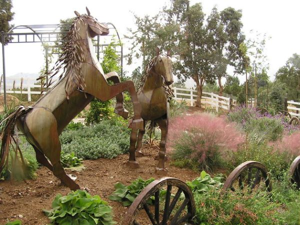 Stunning horse sculptures make a fascinating addition to this distinctive garden