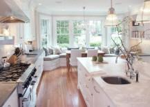 Stunning-modern-kitchen-in-pristine-white-where-pendant-lights-take-a-rare-backseat-217x155