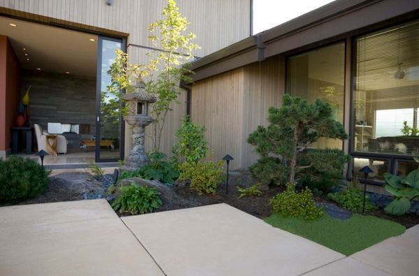 Stylish Asian garden with compact design and a stone lantern at its heart