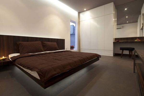 Stylish contemporary bedroom with giant wooden floating bed