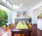 Stylish dining area with sliding glass doors providing access to a small balcony
