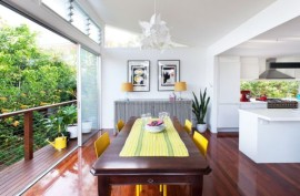 Stylish dining area with sliding glass doors providing access to a small balcony