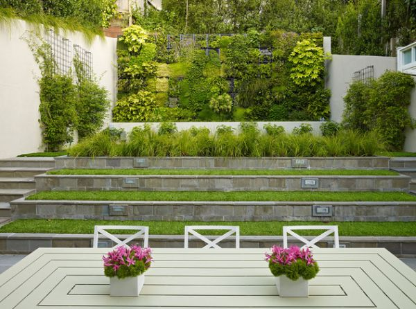 Terraced planters and a living wall make for fine garden art installations in an urban setting