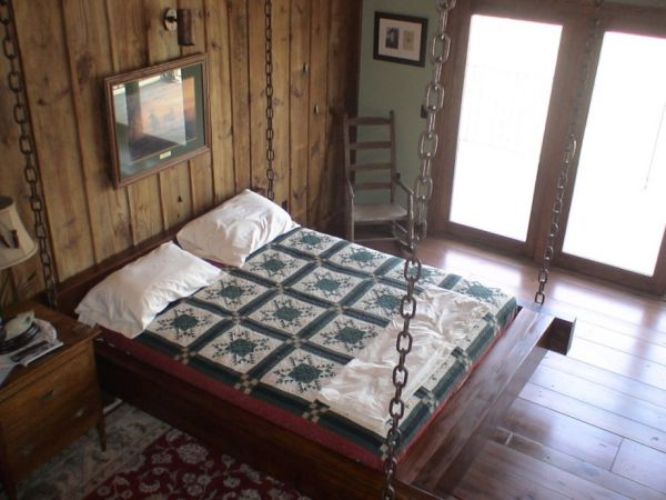 Timber frame hanging bed for the rustic look