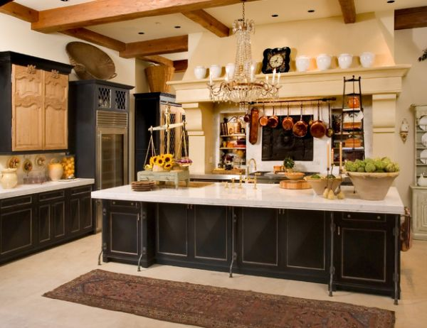 Traditional kitchen design with a glass door refrigerator that blends in seamlessly