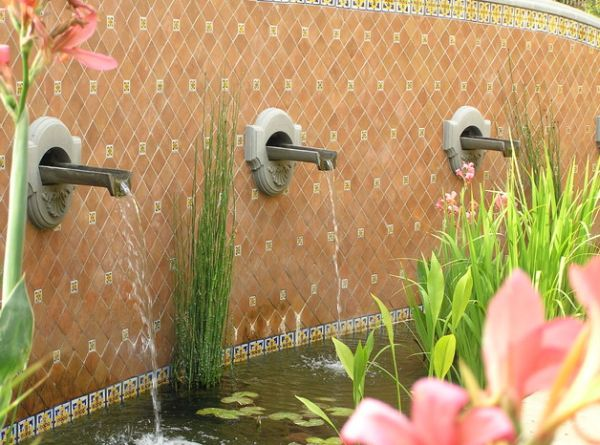 Trough like fountain spouts turn flowing water into a sculptural delight decoist - Decorative water spouts ...
