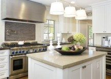 Unique pendant lights that offer a softer light for this neutral kitchen