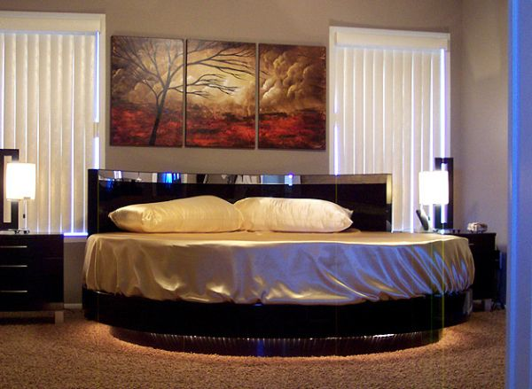 Vivacious bedroom with a flashy circle bed at its center