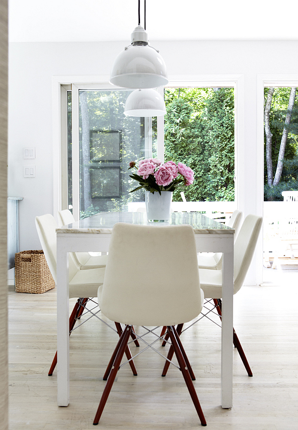 White dining room with purple flower arrangement