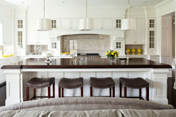 White kitchen with a large island and dark contrasting countertop