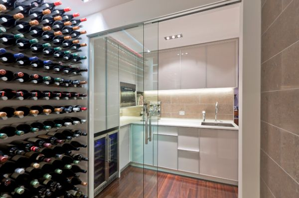 Wine cellar and a small kitchen connected visually using sliding glass doors