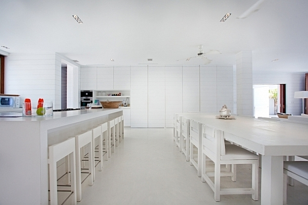 all white kitchen and dining area