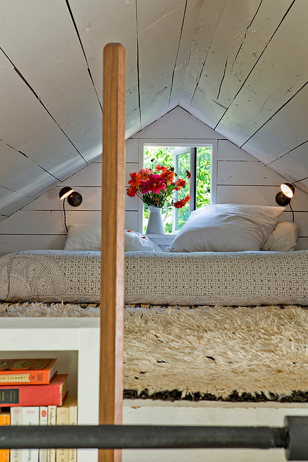 Attic bedroom with fresh flowers