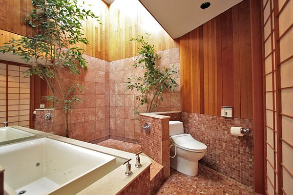 Bathroom with a privacy wall for the toilet