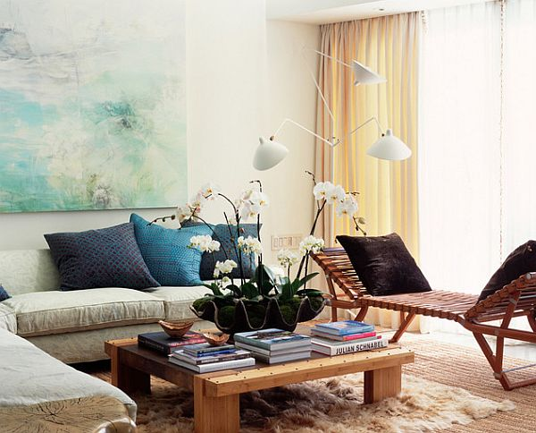 beautiful artwork in a colorful living room Tips for Hanging Framed Artwork and Photos