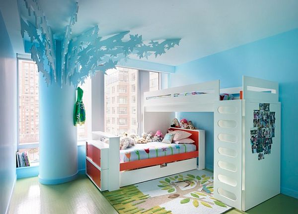 Blue kids bedroom with bunk beds and tree