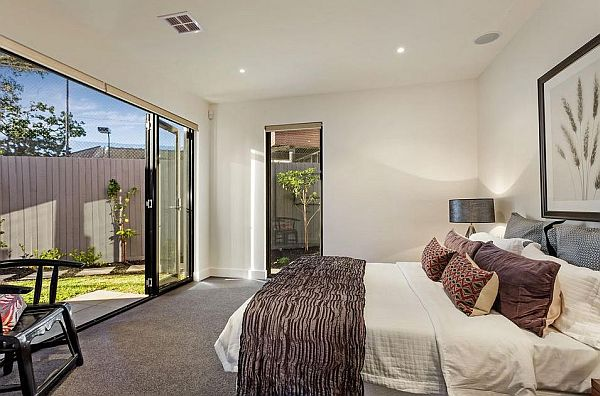 bright bedroom with garden Elegant Melbourne Home Blends Luxurious Interiors With Beautiful Terrace Views
