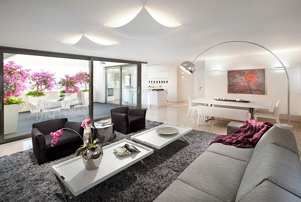 Contemporary living room with purple flowers