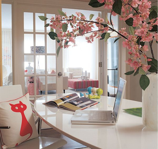 Cozy home office with blossomed flowers