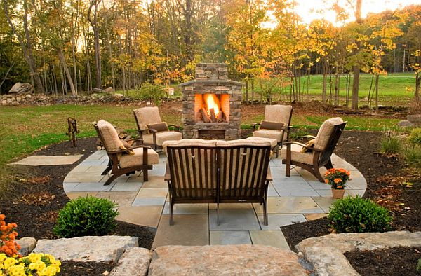 Outdoor stone barbecue with surrounding mulch floor