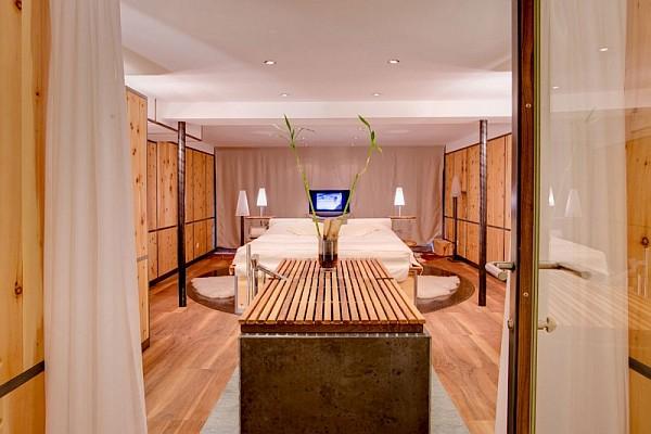 stylish bedroom with wooden furnishings - zermatt, switzerland