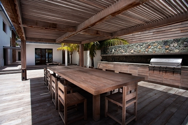 stylish outdoor patio with wooden table and chairs