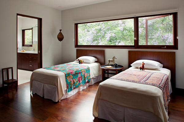 traditional bed in large bedroom